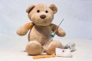 Teddy bear with a syringe and a vaccine