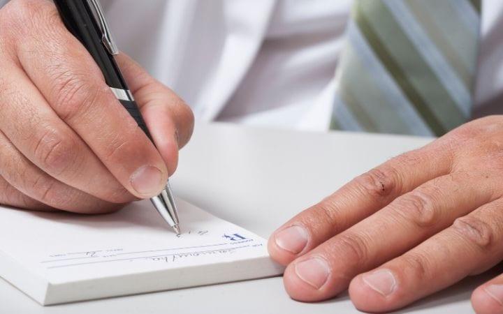 Veterinarian writing prescription - I Love Veterinary