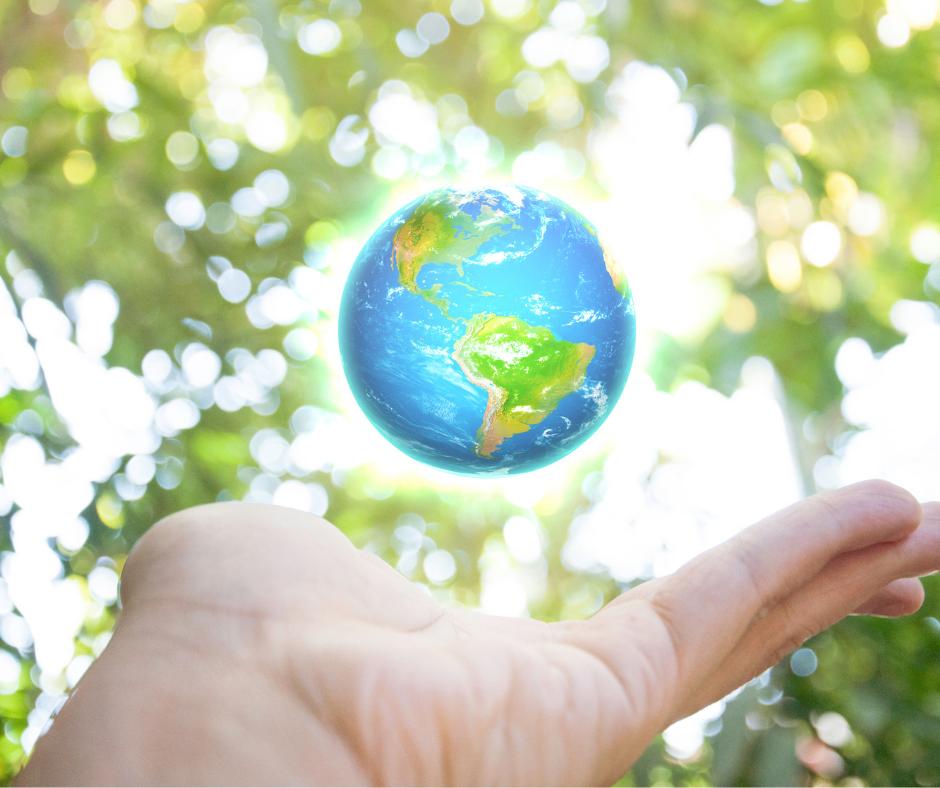 Mini earth globe on top of a human hand